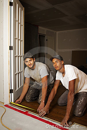 Multi ethnic team working on flooring