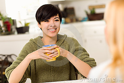 Multi-ethnic Young Woman Socializing with Friend