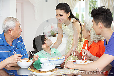 Multi-Generation Chinese Family Eating Meal