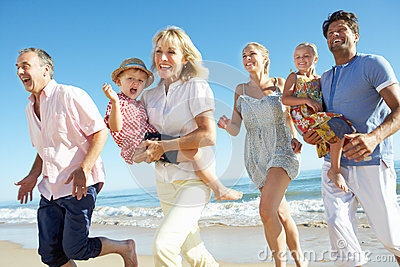 Multi Generation Family Enjoying Beach Holiday