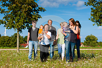 Multi-generation family on meadow in summer