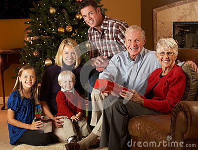 Multi Generation Family Opening Christmas Presents