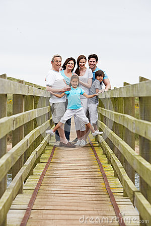 Free Multi Generation Family Walking Along Wooden Bridge Royalty Free Stock Photos - 33089088