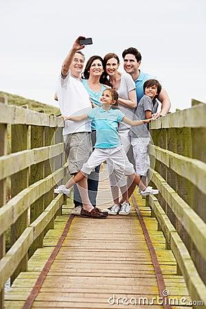 Free Multi Generation Family Walking On Bridge Taking Photo Royalty Free Stock Image - 33089136