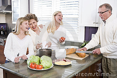 Multi-generational family making lunch in kitchen