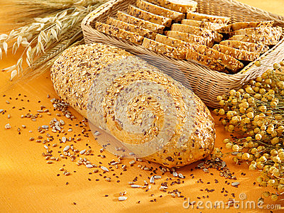 Multi-grain bread and wheat on table