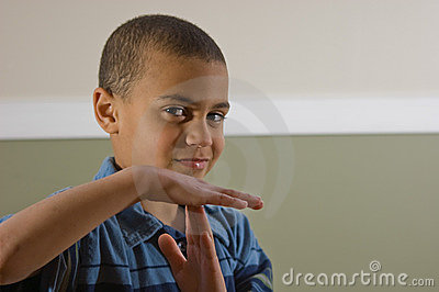 Multi Racial Boy Signaling a Time Out