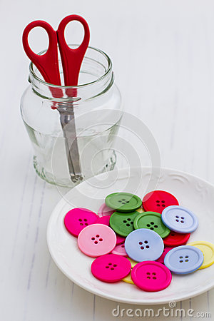 Multicolor buttons on white plate