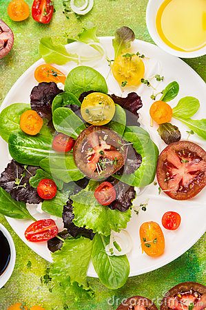 Free Multicolor Tomatoes Various Salad In White Plate With Greens, Oil And  Balsamic Vinegar, Top View Royalty Free Stock Photography - 52717167