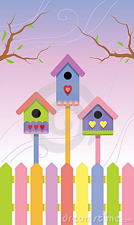 Multicolored birdhouses on spring background
