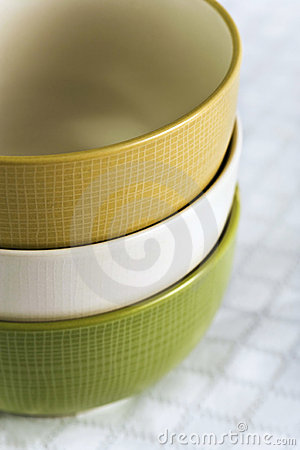 Multicolored Bowls On White Tablecloth