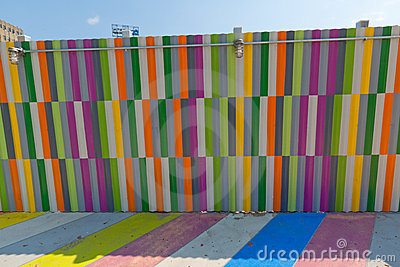 Multicolored painted sidewalk and walls.