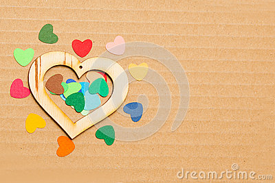 Multicolored paper hearths with a wooden  heart