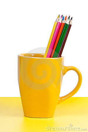 Multicolored pencils in yellow cup