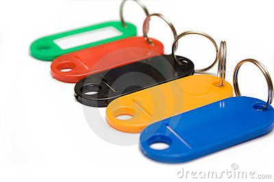Multicolored plastic trinkets on white background