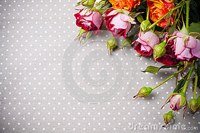 Multicolored roses on gray linen fabric