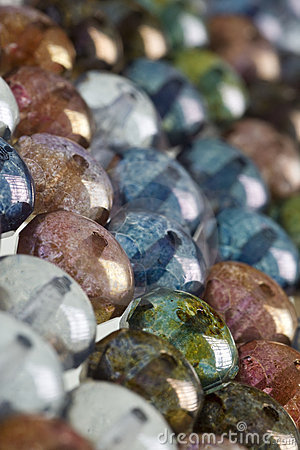 Multicolored round beads in background pattern