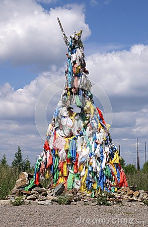 Multicoloured prayer flags on ovoo - shamanistic or buddhistic c