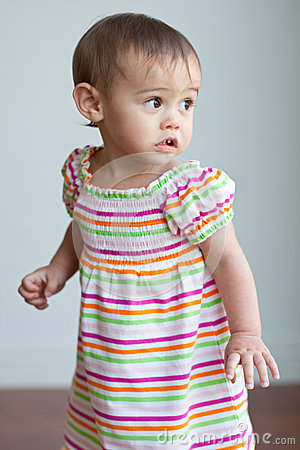 Multicultural toddler girl in cute dress