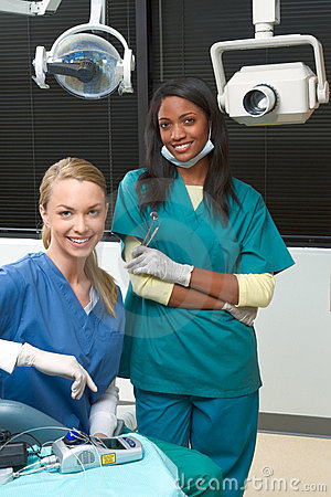 Multiethnic dentist office Caucasian and black