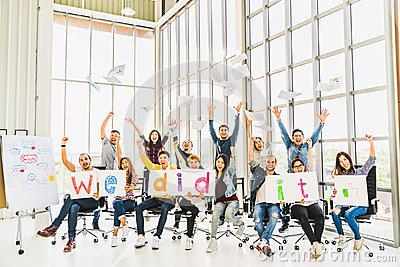 Multiethnic diverse group of happy business people cheering together, celebrate project success with papers wrote words We did it Stock Photo
