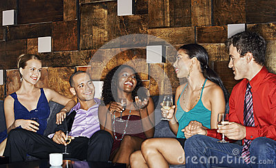 Multiethnic Friends On Couch With Drinks