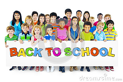Multiethnic Group of Children with Bcak to School Placard Stock Photo