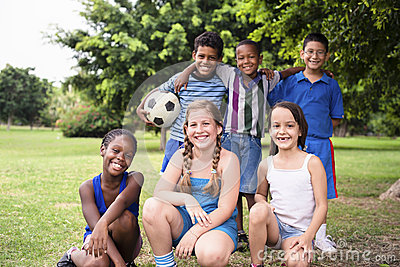 Multiethnic group of children with soccer ball
