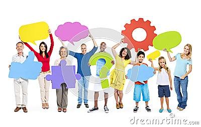 Multiethnic People Holding Social Media Icons Stock Photo