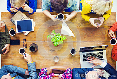 Multiethnic People with Start up Business Talking in a Cafe Stock Photo