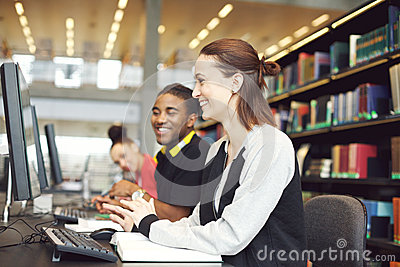 Multiethnic students using computers for finding information for their study