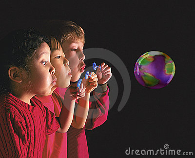 Multinational children blowing bubble