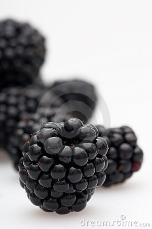 Multiple blackberries staggered in the depth