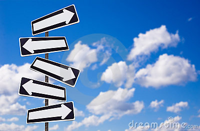 Multiple directions signs on blue sky