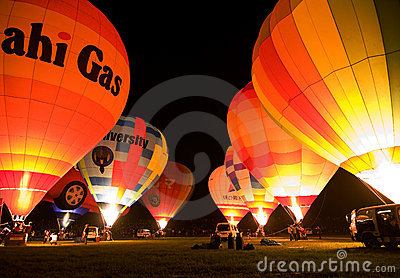 Multiple hot air balloons night glow Editorial Stock Photo
