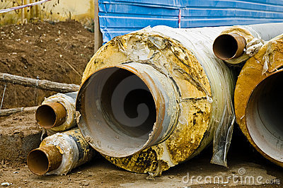 Multiple metal pipes with yellow heat isolation.