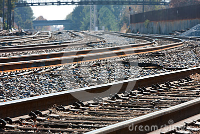 Multiple Train Tracks Curl Into The Horizon