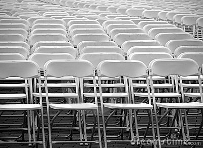 A Multitude of White Plastic Chairs