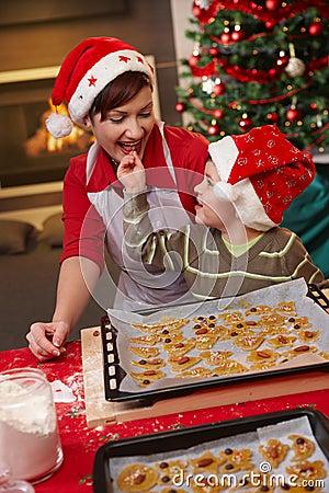 Free Mum And Son Tasting Christmas Cake Stock Image - 16145131