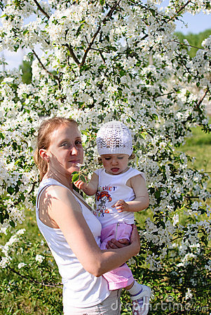 Mum with the child in flowers