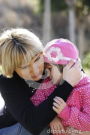 Mum comforting her baby girl