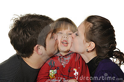 Mum and the daddy kiss the son.