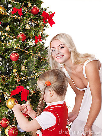 Mum with a daughter decorate christmas tree.