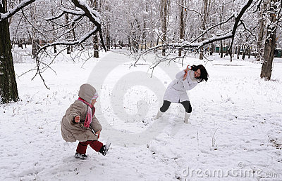 Mum and the daughter play snowballs