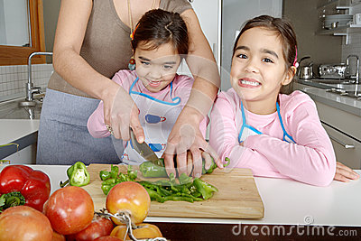 Mum and Daughters Chopping Veggies