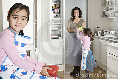 Mum and Daughters In Kitchen