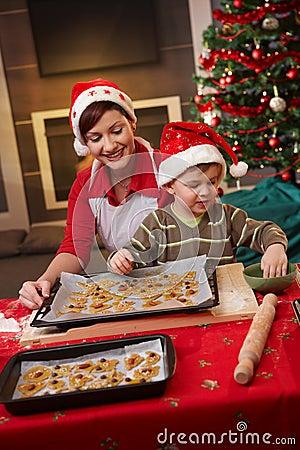 Mum and son decorating christmas cake