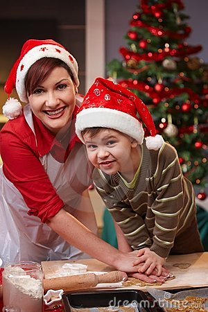 Mum and son having fun at christmas baking