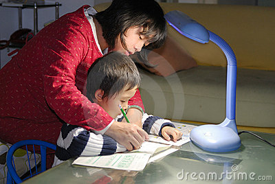 Mum teaching child writting