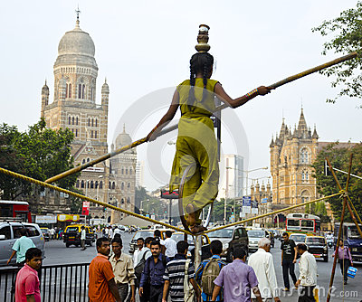 Acrobat Performing On-street Rope-Walk Editorial Image